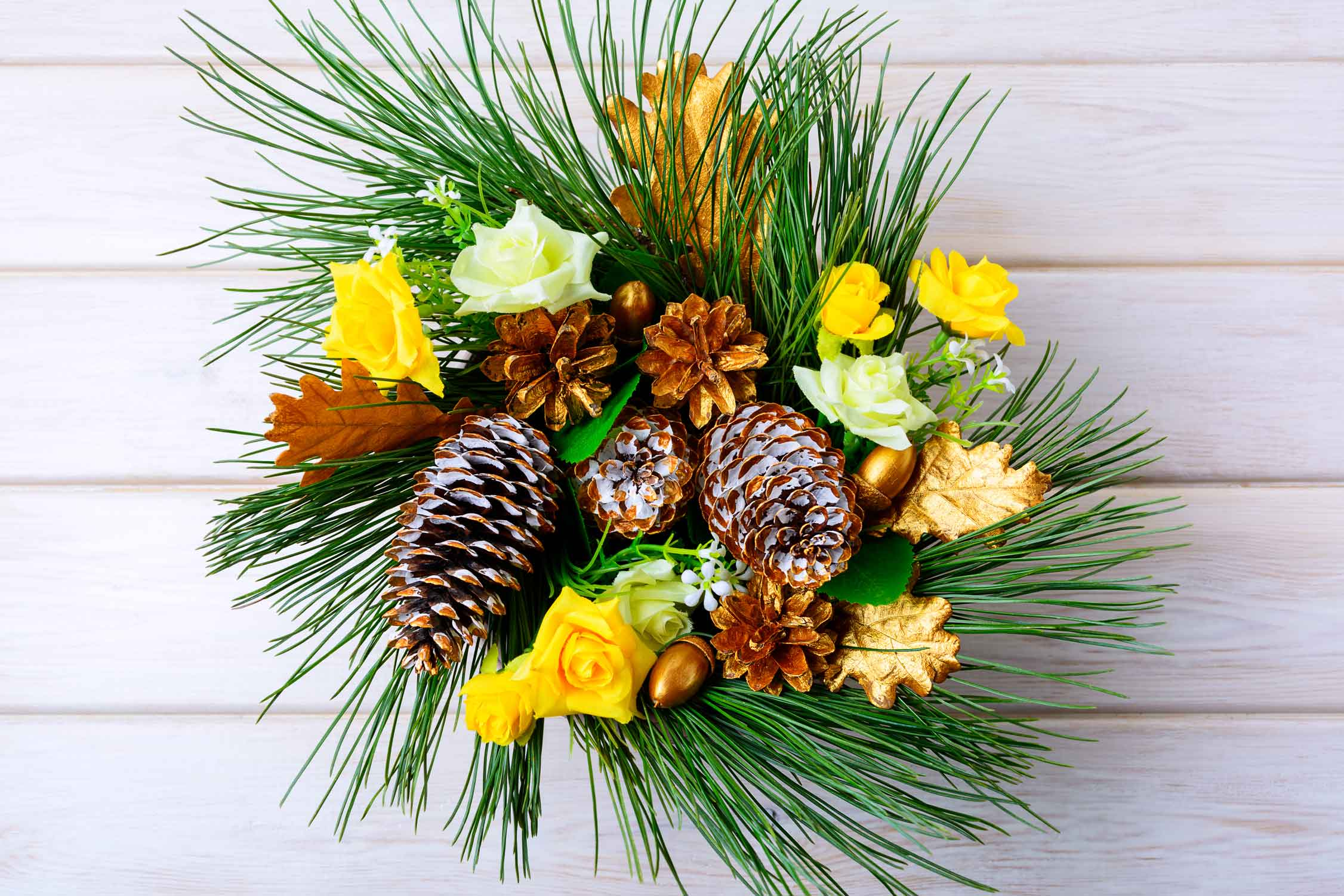 Christmas table centerpiece or door wreath with golden cones