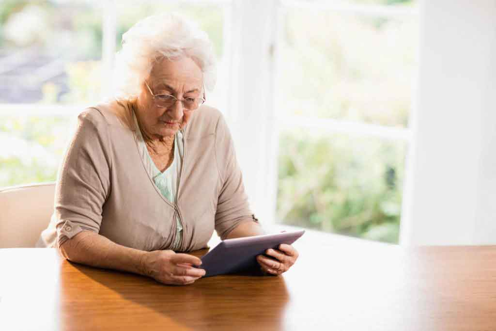 older woman using ipad
