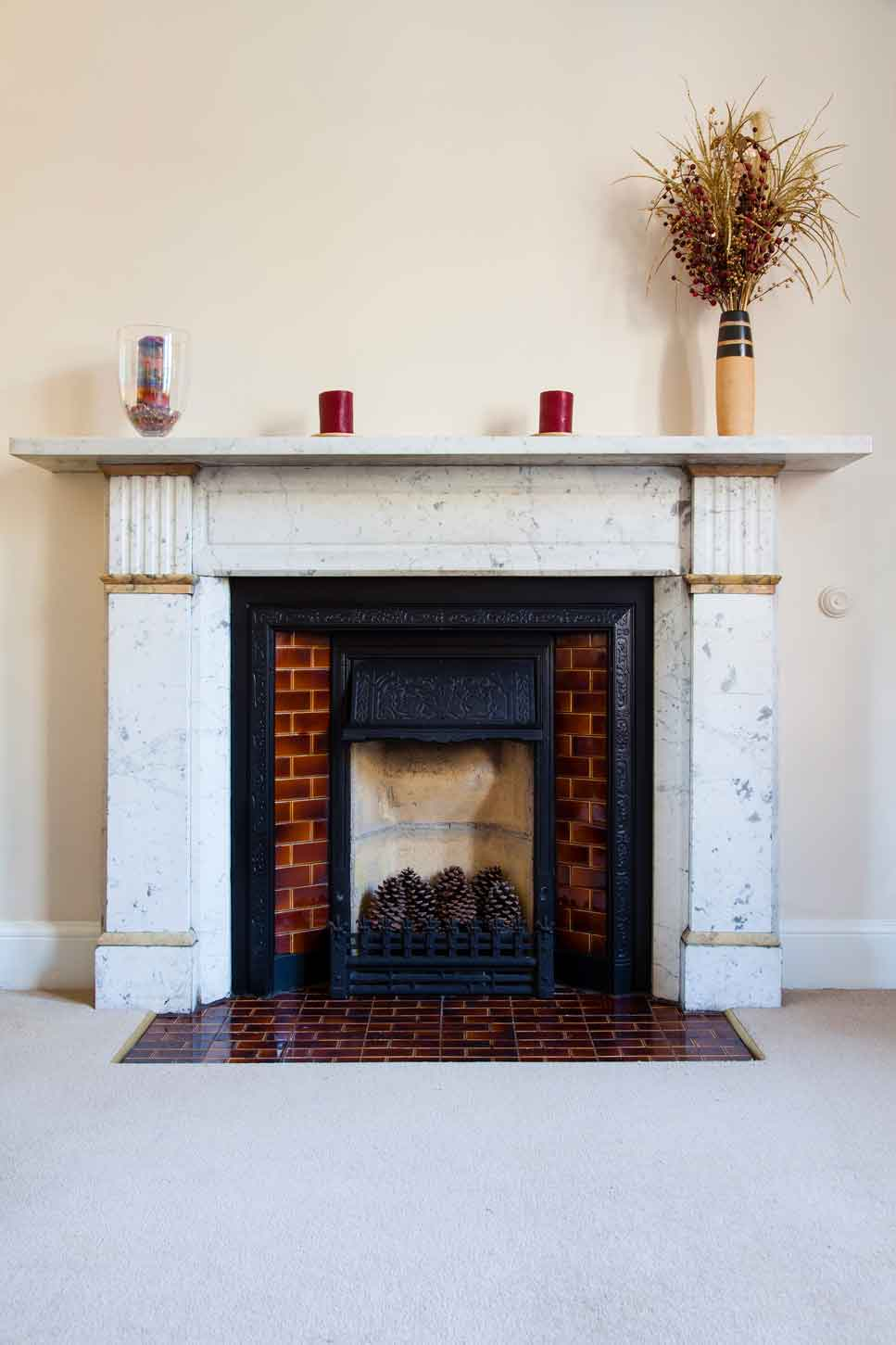 A traditional ornate marble fireplace from a 19th century English home.