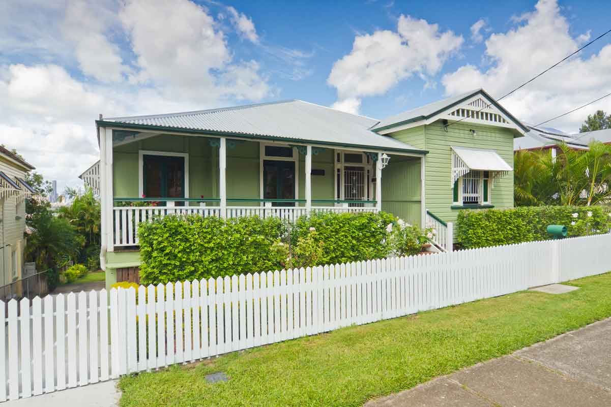 Image of a well presented traditional Queenslander home.