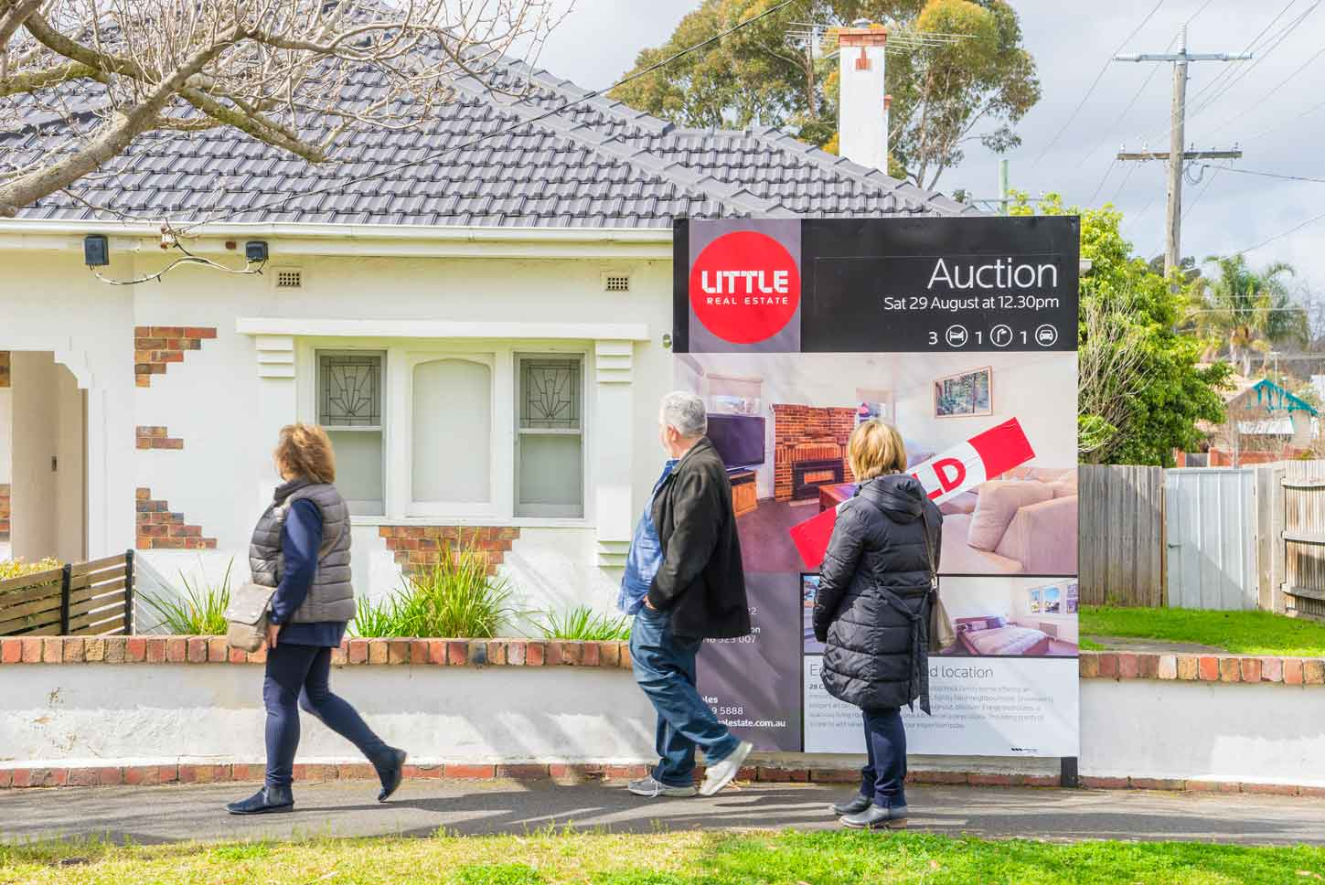 Auction sign on display outside a house in Melbourne