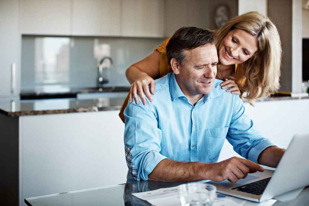 couple researching real estate agents online