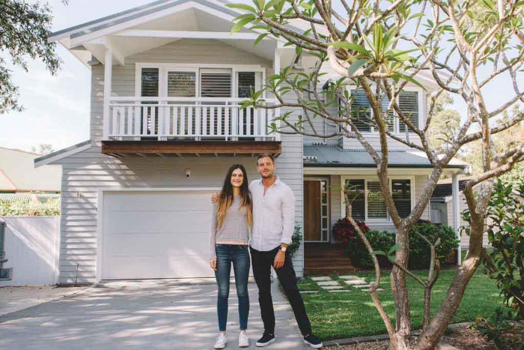couple out the front of home