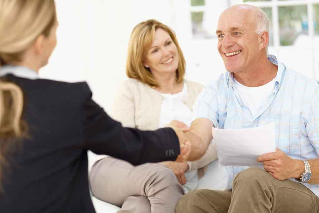 Seniour couple choosing a real estate agent