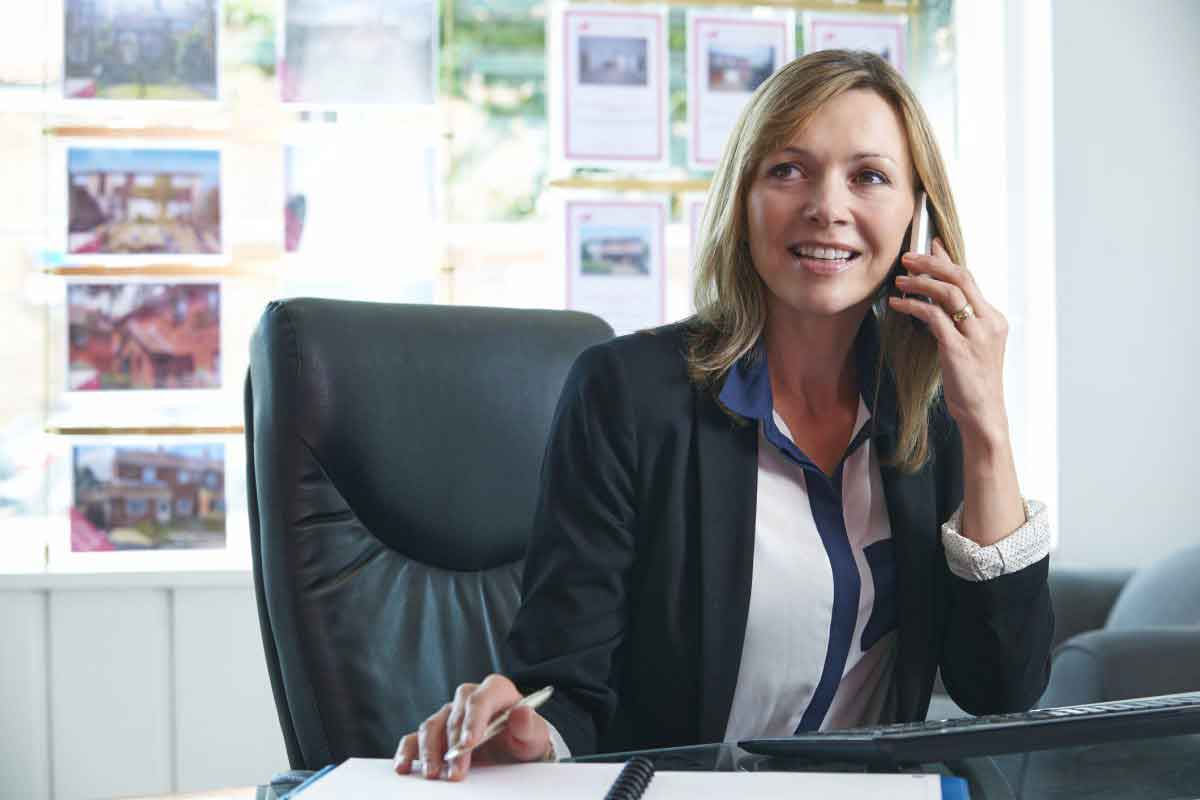 Estate Agent On Phone In Office